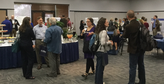 "SoTL Commons attendees ""Speak SoTL"" during the 2016 conference poster session."