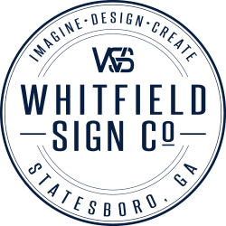 whitfield signs logo, navy blue writing and transparent background