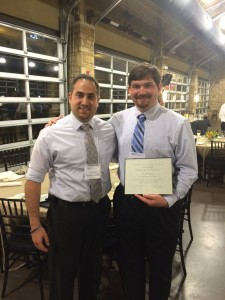 Colin Daly shows of his award with his faculty mentor Dr. Rami Haddad.