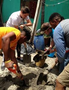 Students mixing cement for a home in La Carpio, Costa Rica