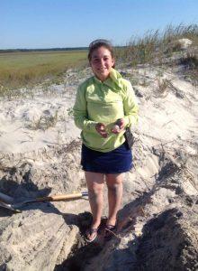 Ann DeLua with turtle egg