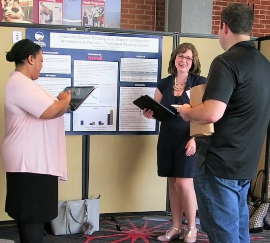 Past participants Desiree Riley and Lauren Barbeau present the findings of their SoTL FLC project at the USG Teaching and Learning Conference.